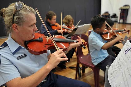 Senior Constable Sharon Radau learns with the children. Picture: The Age